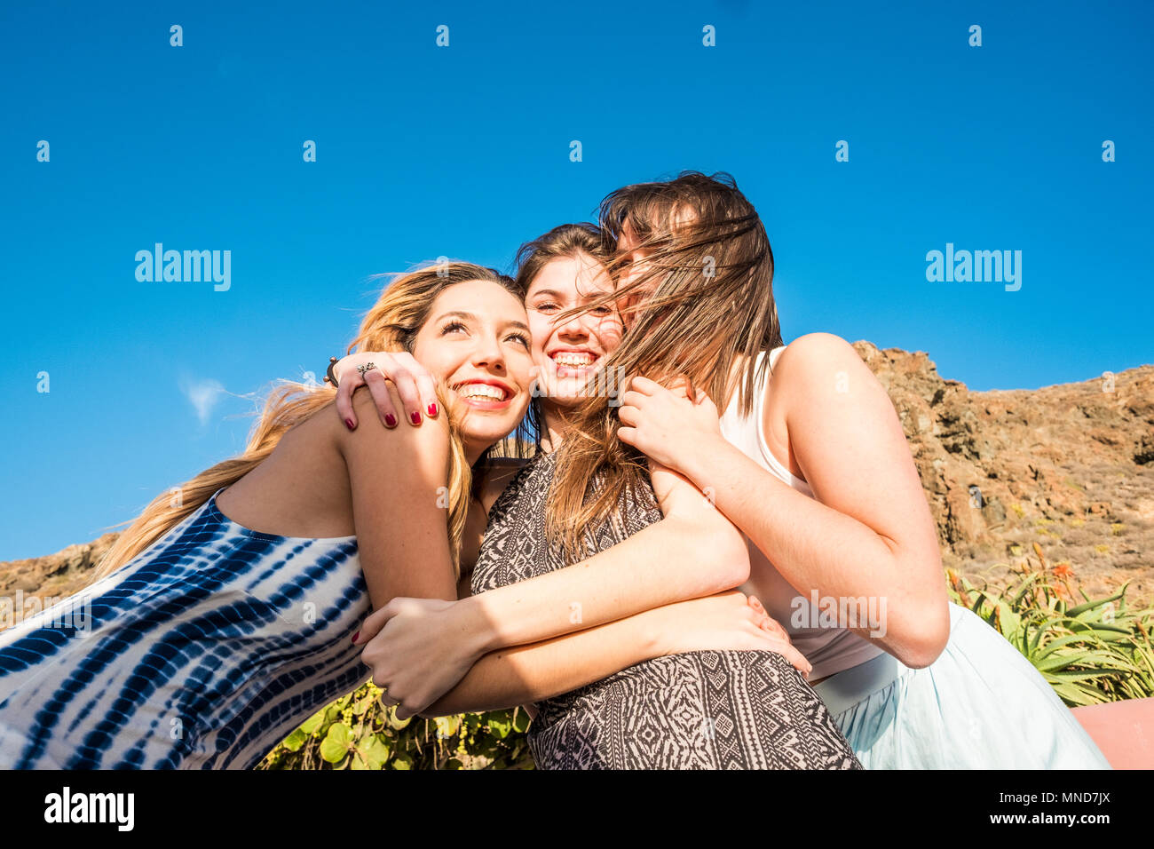 Three girls kissing at the same time